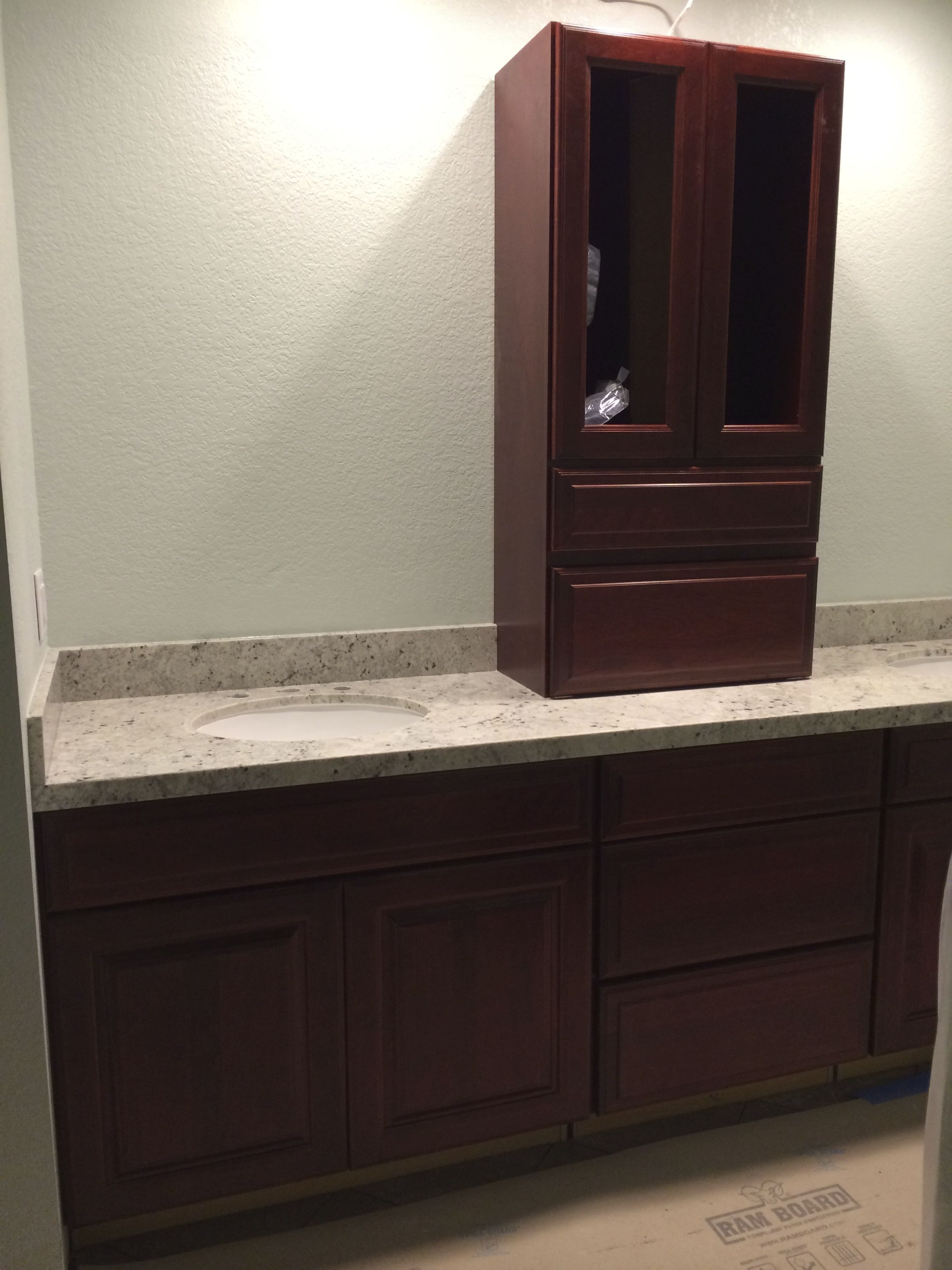 Bathroom Remodeling Timeline day 16 - colonial white granite counter top installationj.e.