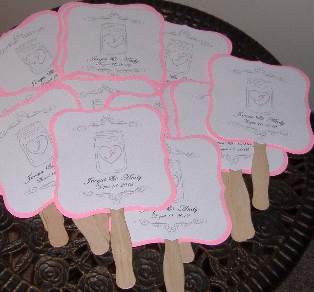 wedding fan with mason jar and pink backing