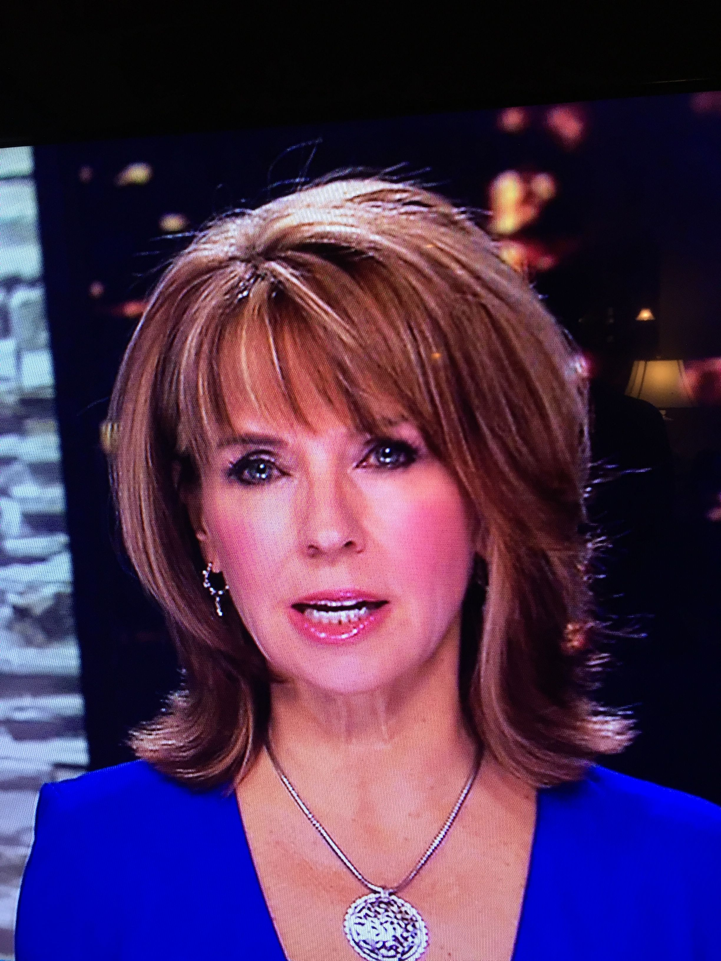 modern flip hairdo on news anchor, kim christiansen, for