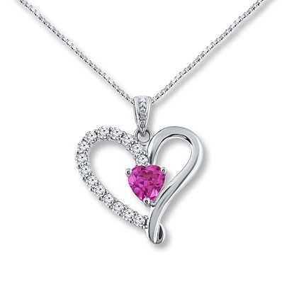 Celebrate your mother's love with a gorgeous lab-created pink sapphire heart necklace.