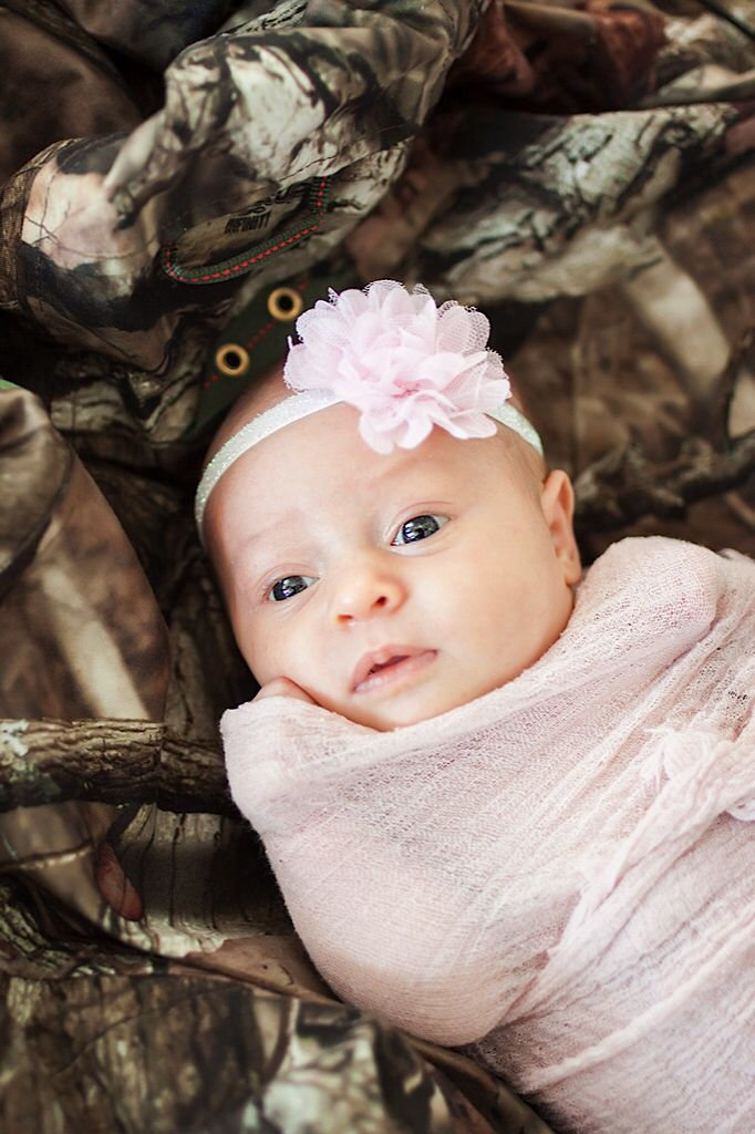 c11bbbf69da54 Newborn on Daddy's Hunting Camo Newborn Photography Pictures Daddy's ...