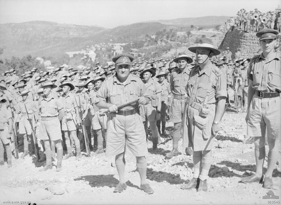 """Hammana, Lebanon. September 2, 1941. Major General A. S. """"Tubby"""" Allen (centre), commander of the Australian 7th Division, with Lt Colonel Murray Moten (centre right), commander of the 2/27th Infantry Battalion and his men. (Photographer: Frank Hurley)"""