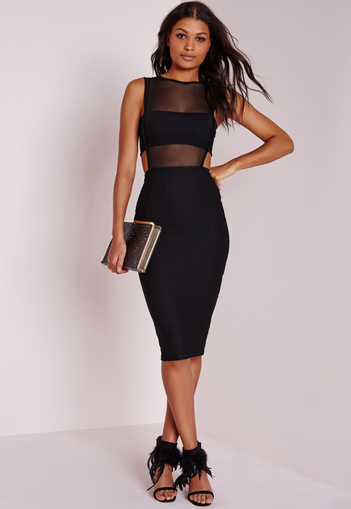 cf44dfcf0961 Step out in style and look totally chic in this cut out black midi dress.  With mesh panel insert on the front, back zip fastening and cut out detail  on the ...
