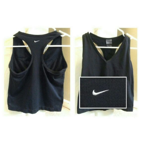Nike Dri-Fit Tank built-in bra This Nike Dri - Fit race back tanktop with built-in sports bra is essential for every athlete's closet! Black breathable mesh Dri-Fit material allows you to comfortably workout when you sweat. Sports bra secured into front of the top to allow for full support. Nike logo embroidered on the back, wont wear off. Excellent condition with no damages, tears or stains. Workout in Nike! Nike Tops Tank Tops