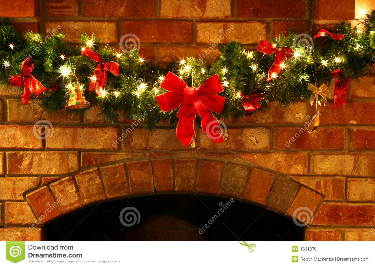 Photo About A Christmas Garland On A Brick Fireplace With Fairy Lights And Red Bows Imag In 2020 With Images Christmas Lights Garland Christmas Fireplace Decor Christmas Garland