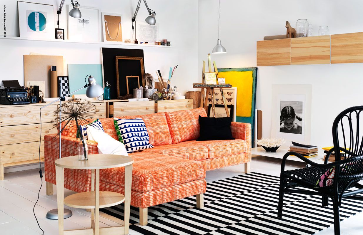 ikea   orange couch black furniture with stripes rug
