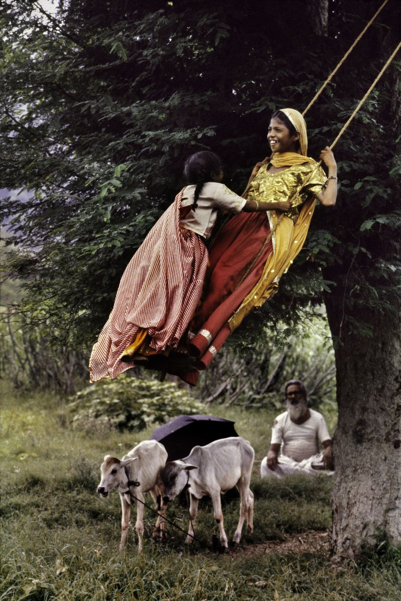 This photograph of girls on a swing was taken in India. Please visit our website for information and news about exhibitions. http://www.stevemccurry.com