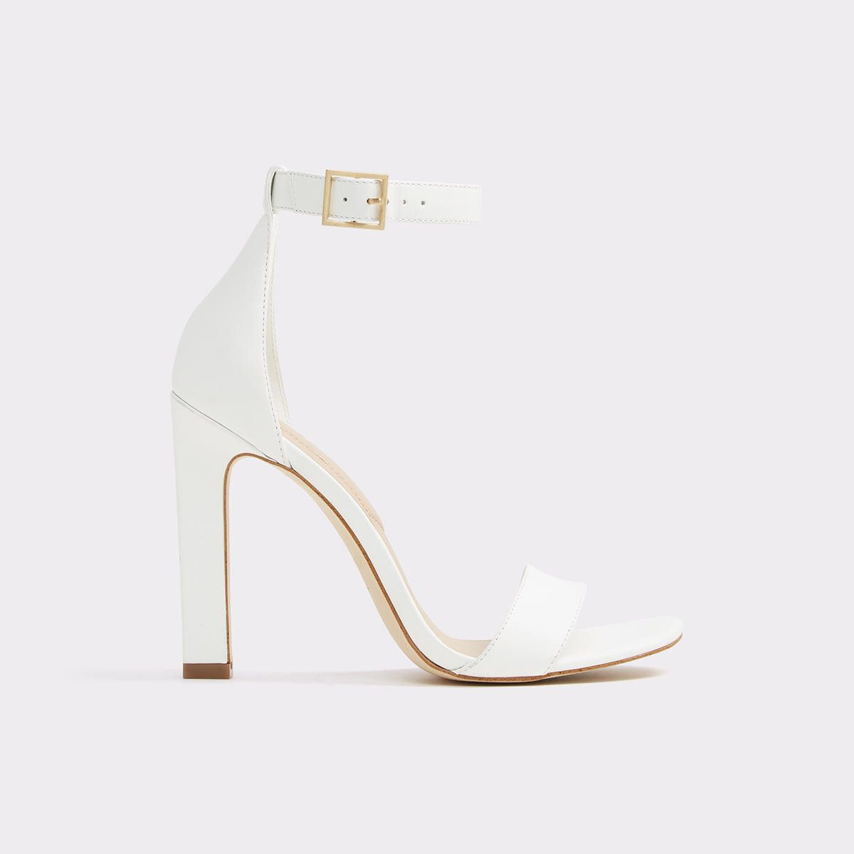 aace44b50f6 Figarro Buckled ankle strap and asymmetrical toe strap take this high heel  dress sandal beyond basic territory.