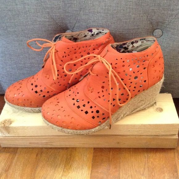 Orange wedges with a roped heel! Super cute, great for any occasion! Worn a bit at the soles but every thing else in great condition! Open to offers and willing to negotiate price! Shoe of soul Shoes Wedges