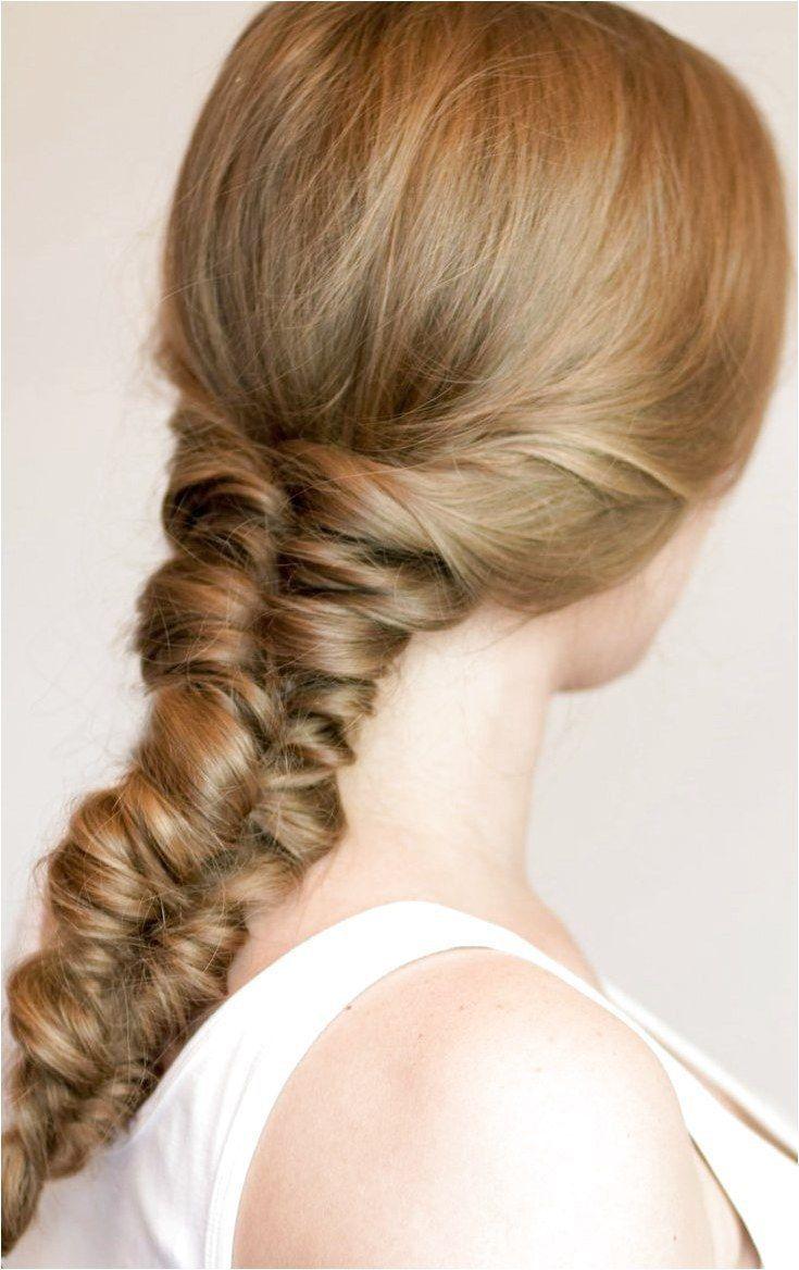 # double fishtail Braids Noelia's double fishtail braid updo done by mom Shameitria