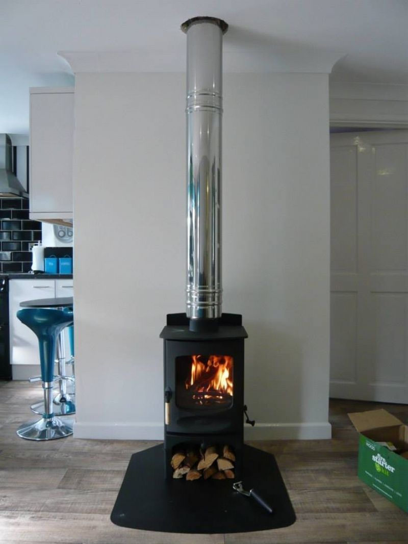 Charnwood C4 With Log Stand Wood Burning Stove Installation By Kernow Fires In Burnin Stove Installation Freestanding Fireplace Wood Burning Stove