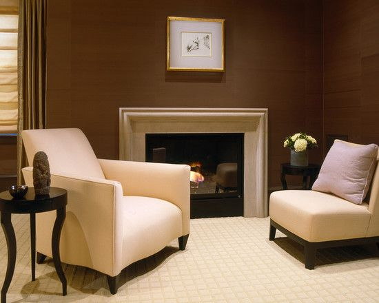White or cream fireplace surround against a dark brown for Brown colors for walls