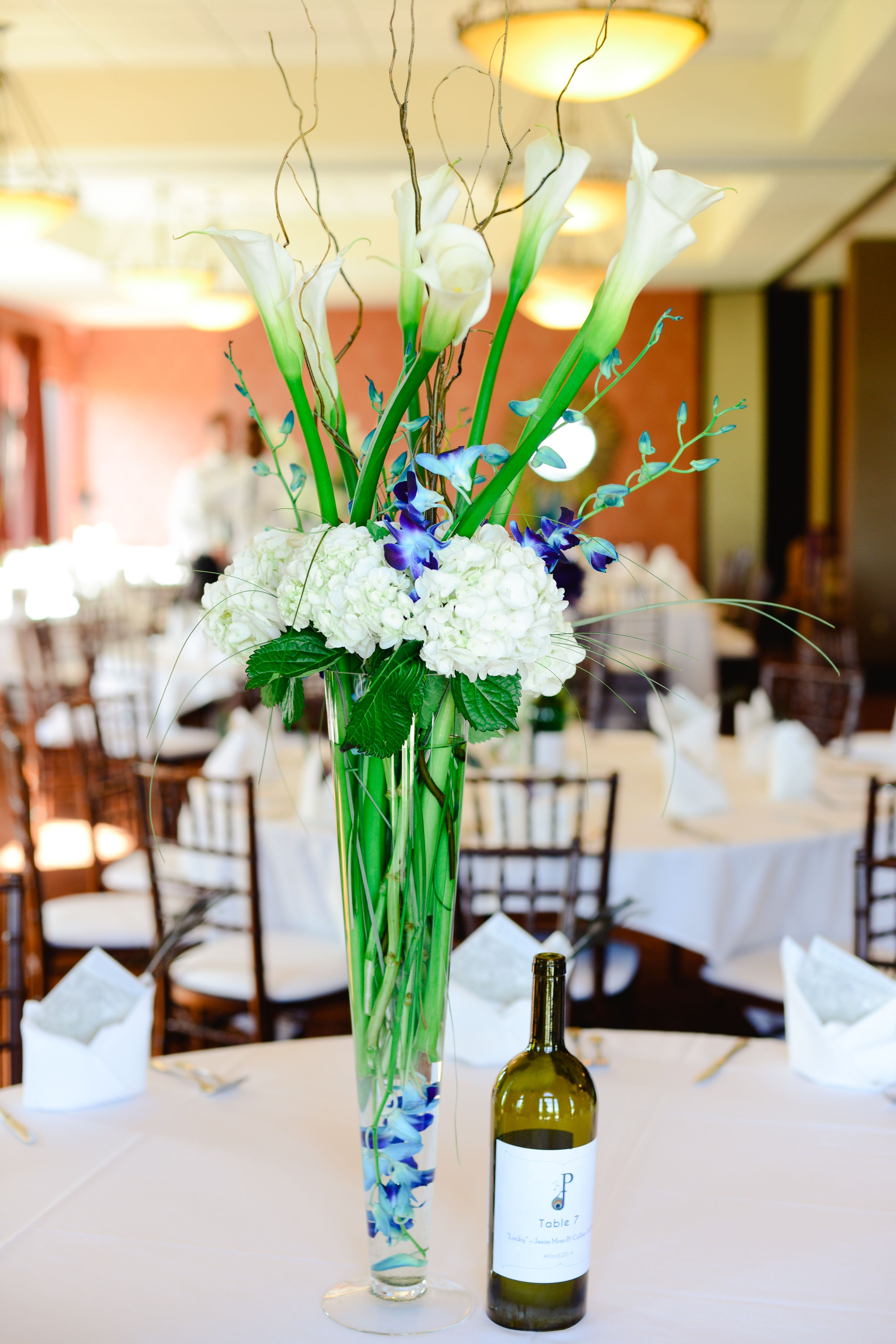 Hydrangea centerpieces in cylinder vases cylinder vase tall floral reception centerpiece blue orchids white hydrangea calla lillies lilly willow branches wine bottles custom reviewsmspy