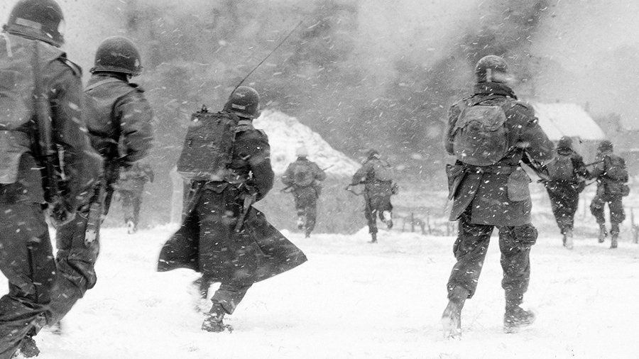 Troops of the 506th PIR, 101st Airborne Division, attack