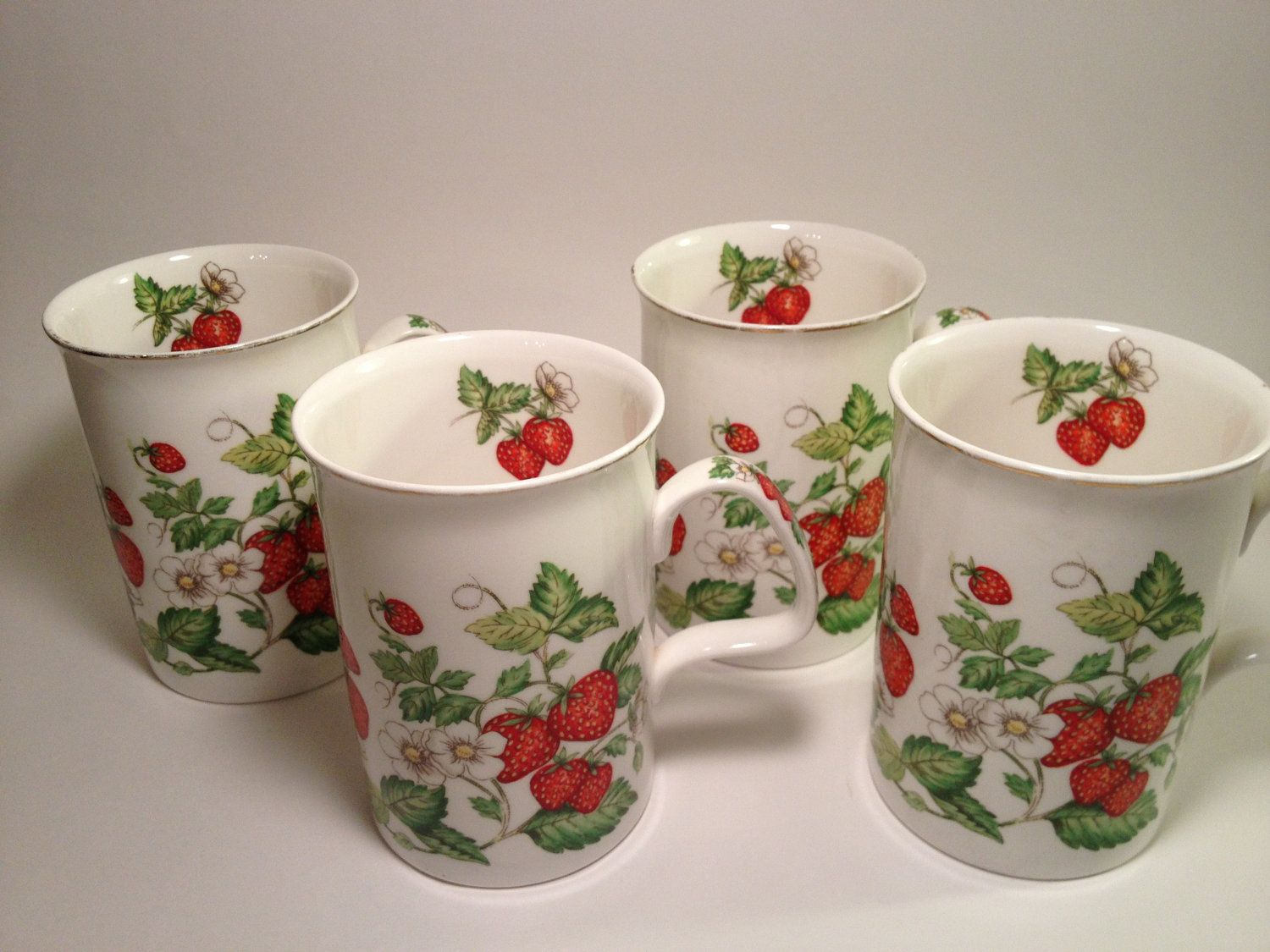 4 Roy Kirkham Strawberry Fayre Fine Bone China Mugs, England, Porcelain, Ceramic, Fruit, Christmas Holiday Cups. $39.50, via Etsy.