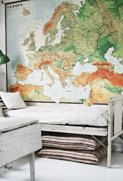 = oversized map and white bed