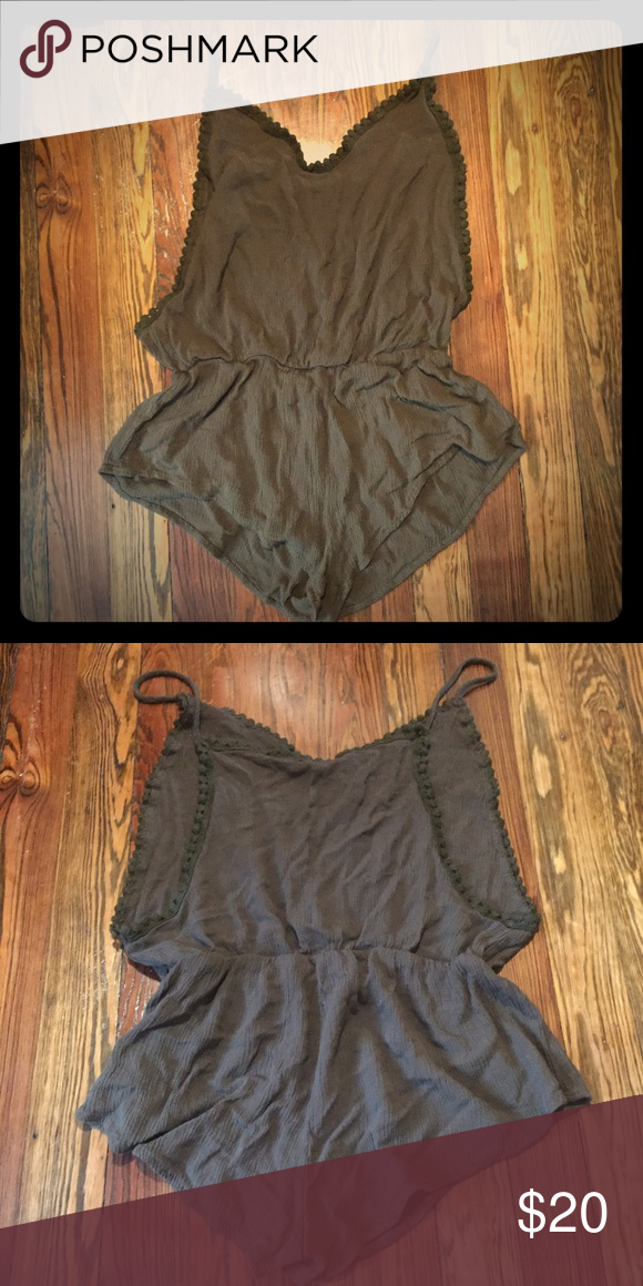 Army Green romper Never wore romper with cut out sides! Super cute to wear with a bralette or as a cover up at the beach! This runs on the smaller side!! Dresses
