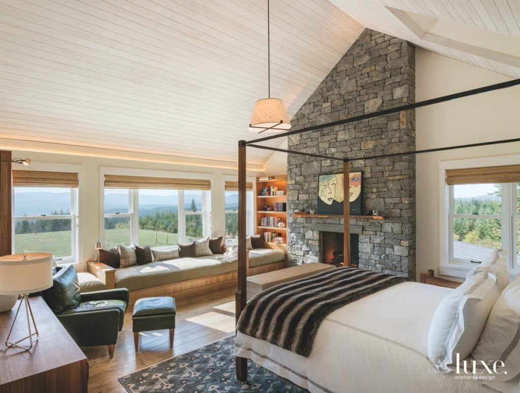 A traditional stone fireplace in a master bedroom is always a winning idea.