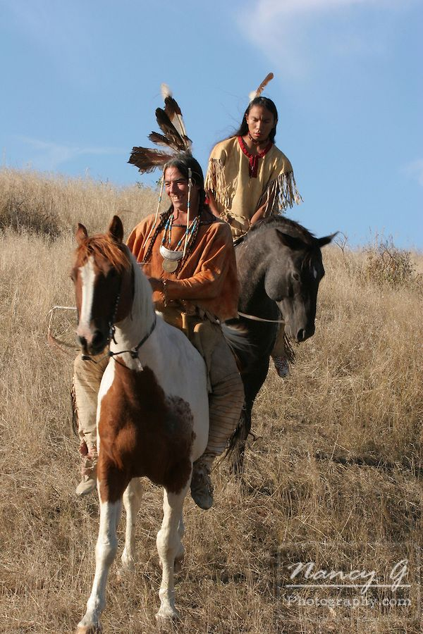 Two Native American Indian men on horseback scouting for ...