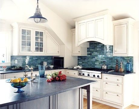 A waterfall backsplash And i LOVE the pendant light and arched part