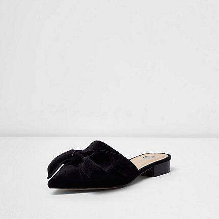 Checkout this Black velvet bow backless mules from River Island