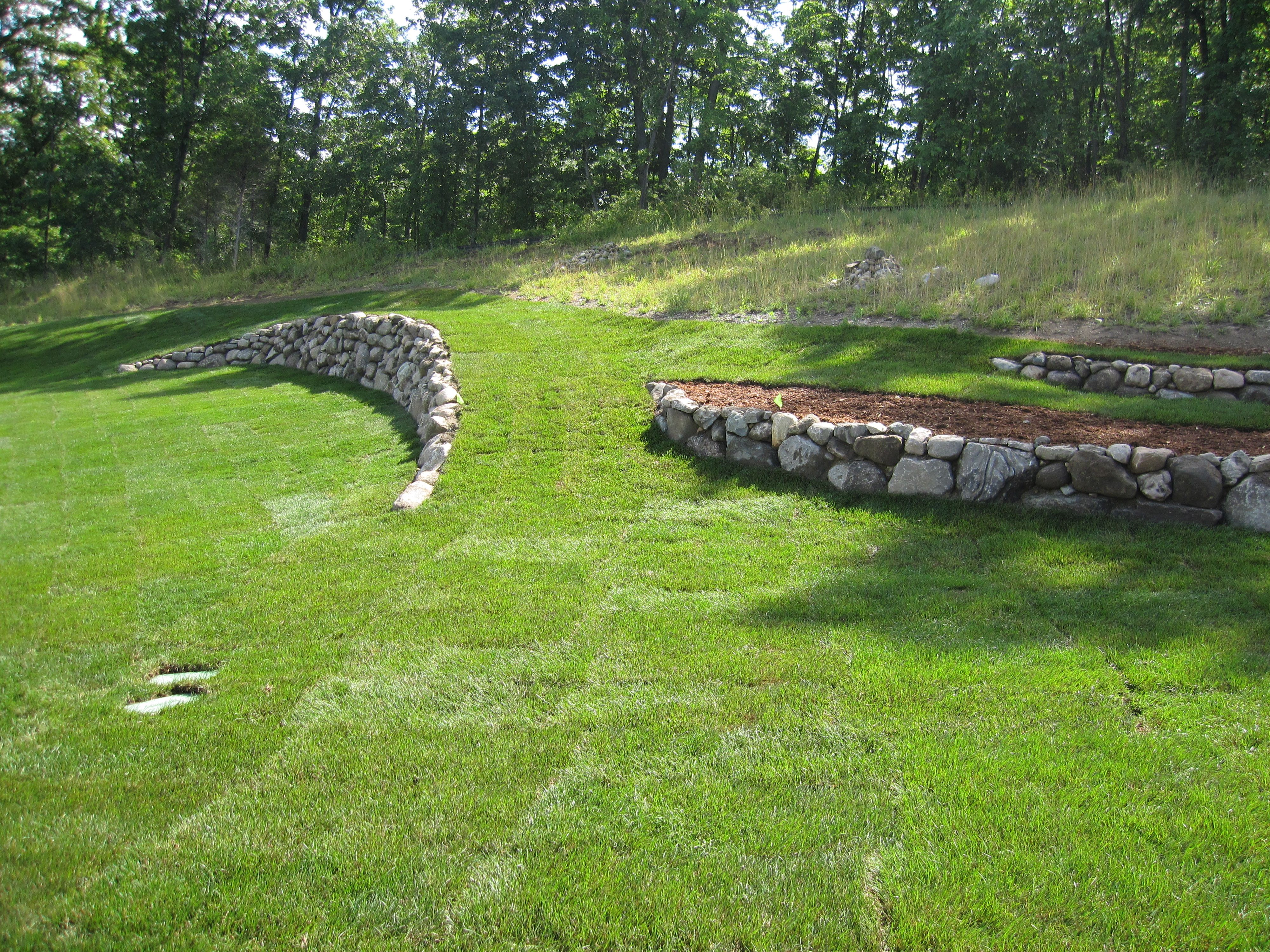 Boulder retaining walls helping to create a more level ... on 2 Level Backyard Ideas id=26442