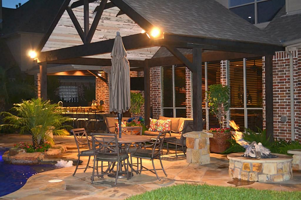 5906 Rose Bush Trail Katy, TX 77494: Photo Sitting Area: Flagstone Decking,  Gas Fire Pit With Bench, Covered Patio With Reclaimed Wood Detail, ...