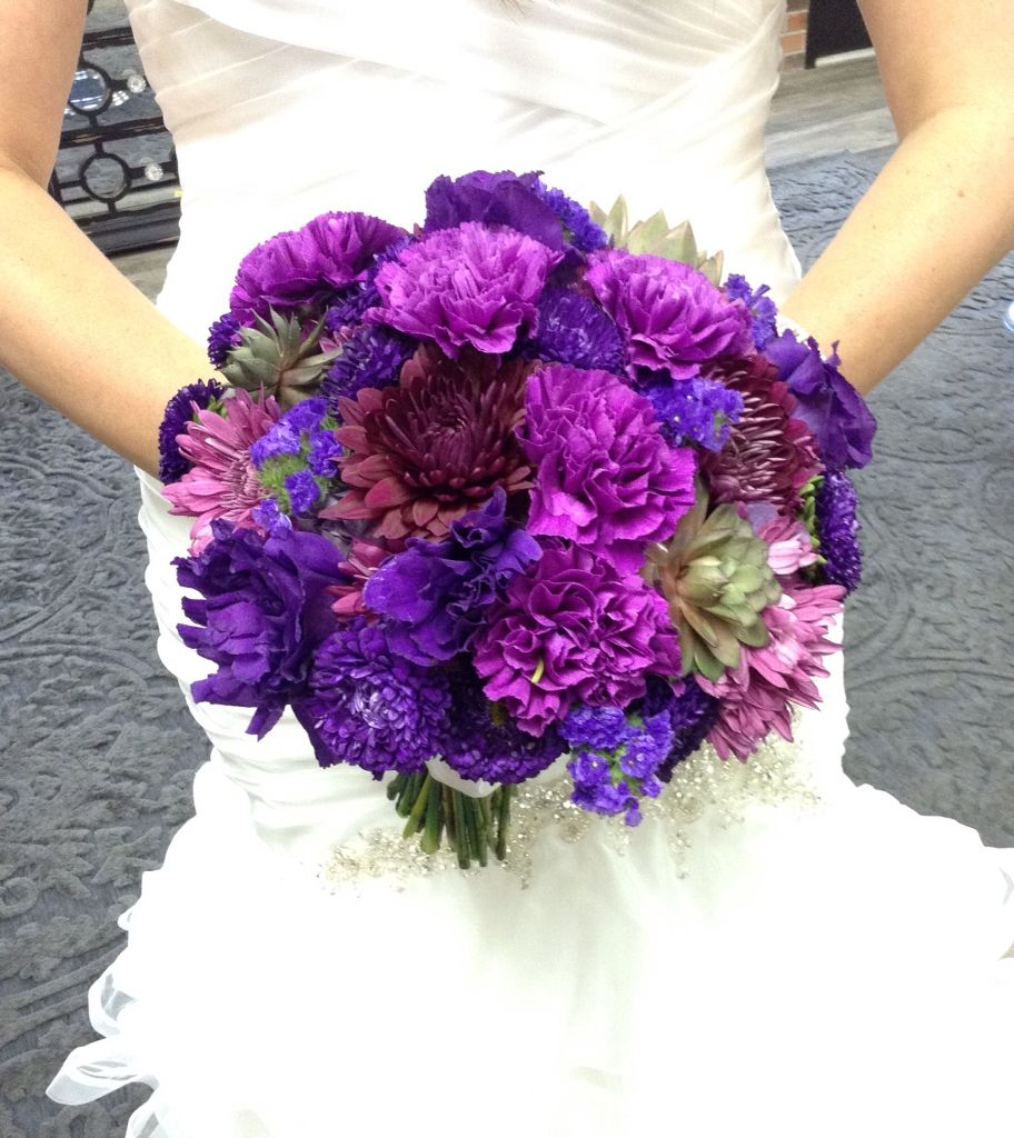 Purple and lavender bridal bouquet with carnations