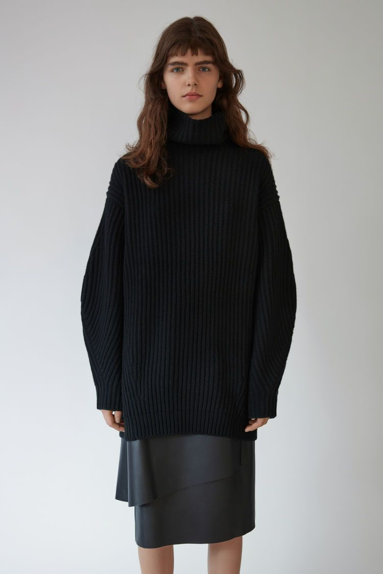65d3f968ba0 Acne Studios Isa wool black is an oversized turtleneck sweater with long  sleeves and large