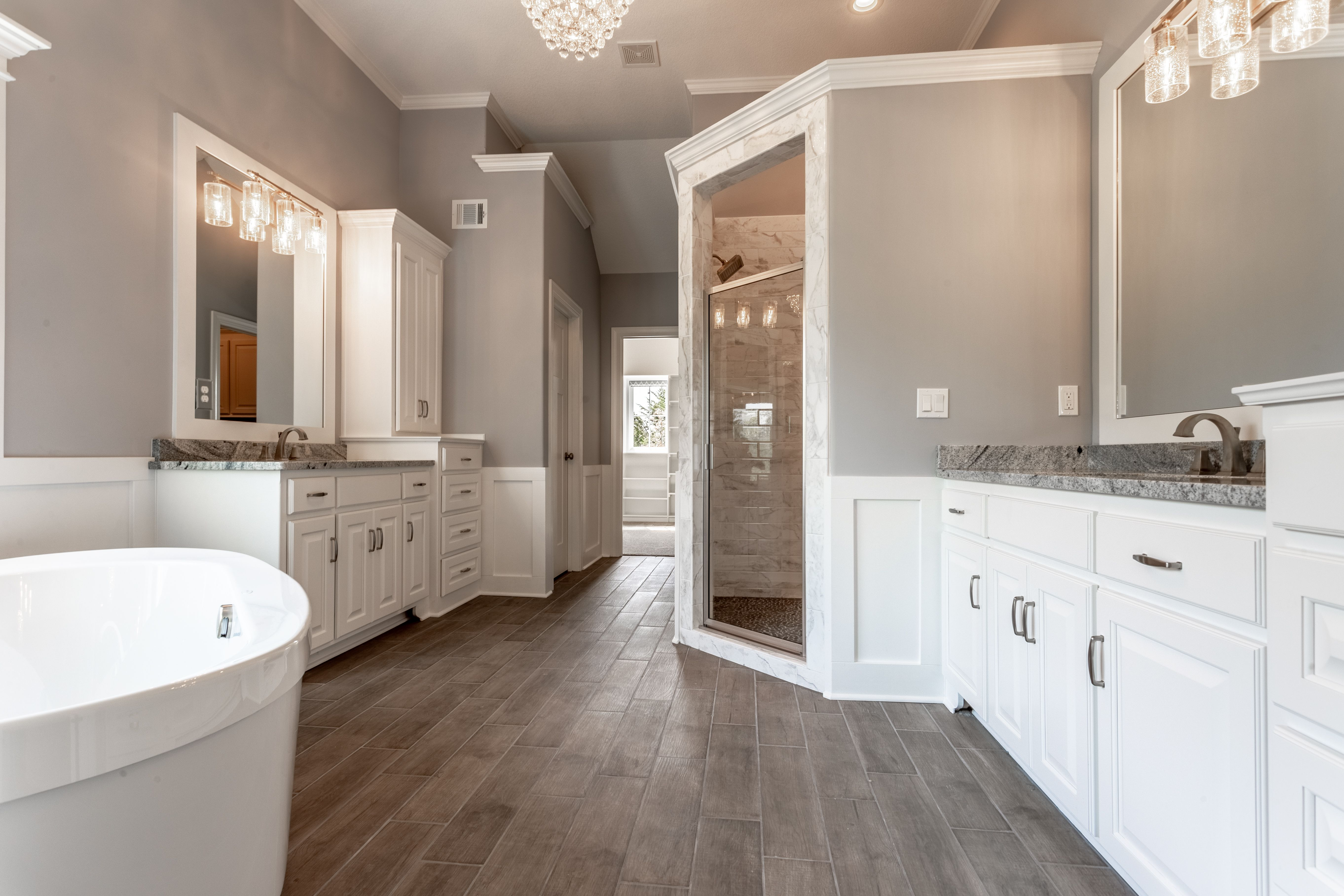 Freestanding Tub White Cabinets Lighting Chandelier Light Fixtures Natural Lighting Wood Tile Floors His And Her V Home Free Standing Tub White Cabinets