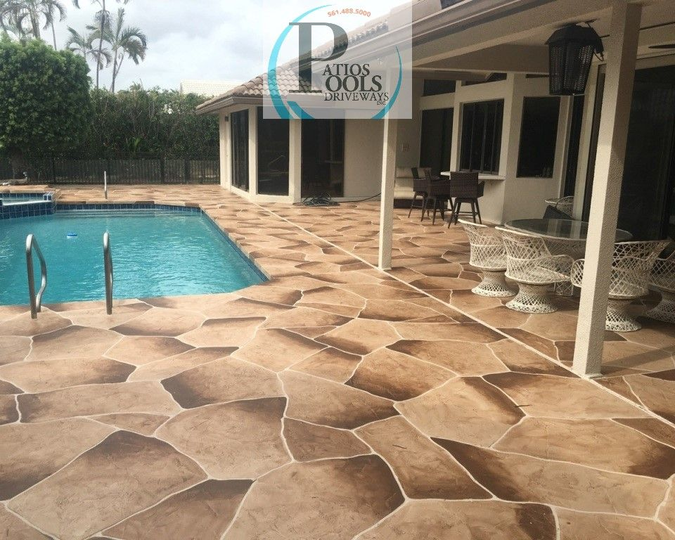 this decorative concrete overlay work not only looks beautiful for
