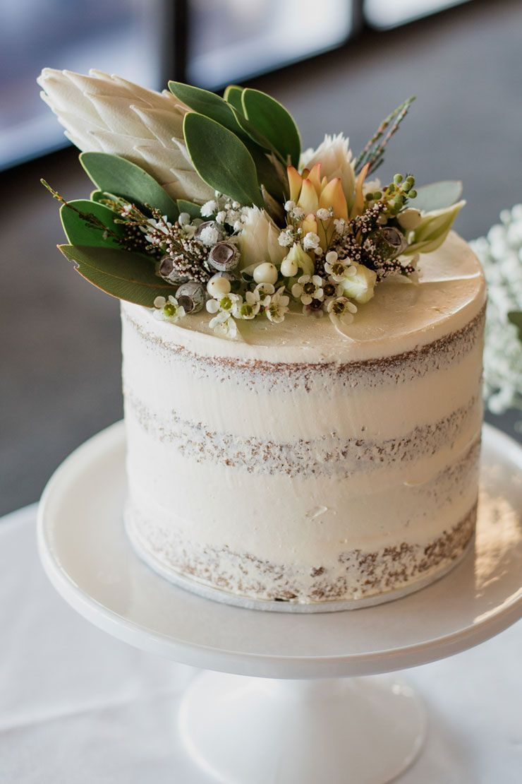 Semi naked single tier rustic wedding cake with australian native