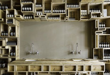 While this is a retail interior, the concept of reclaimed timber boxes as storage could be applied easily to any bathroom. (Aesop's Fillmore Street location by Boston-based architects NADAAA)