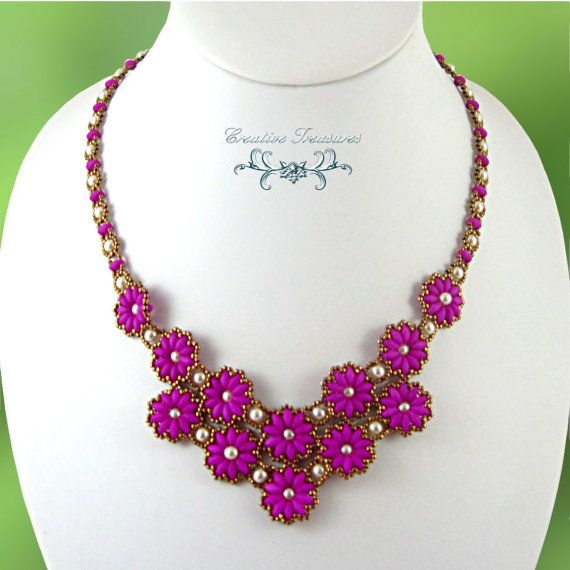 So pretty in striking neon purple, this stunning necklace has two layers of flowers made with neon purple SuperDuo beads, cream glass pearls