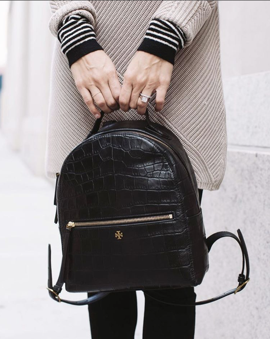 3533d28742 Jacey Duprie of Damsel in Dior toting the Tory Burch Croc-Embossed Mini  Backpack