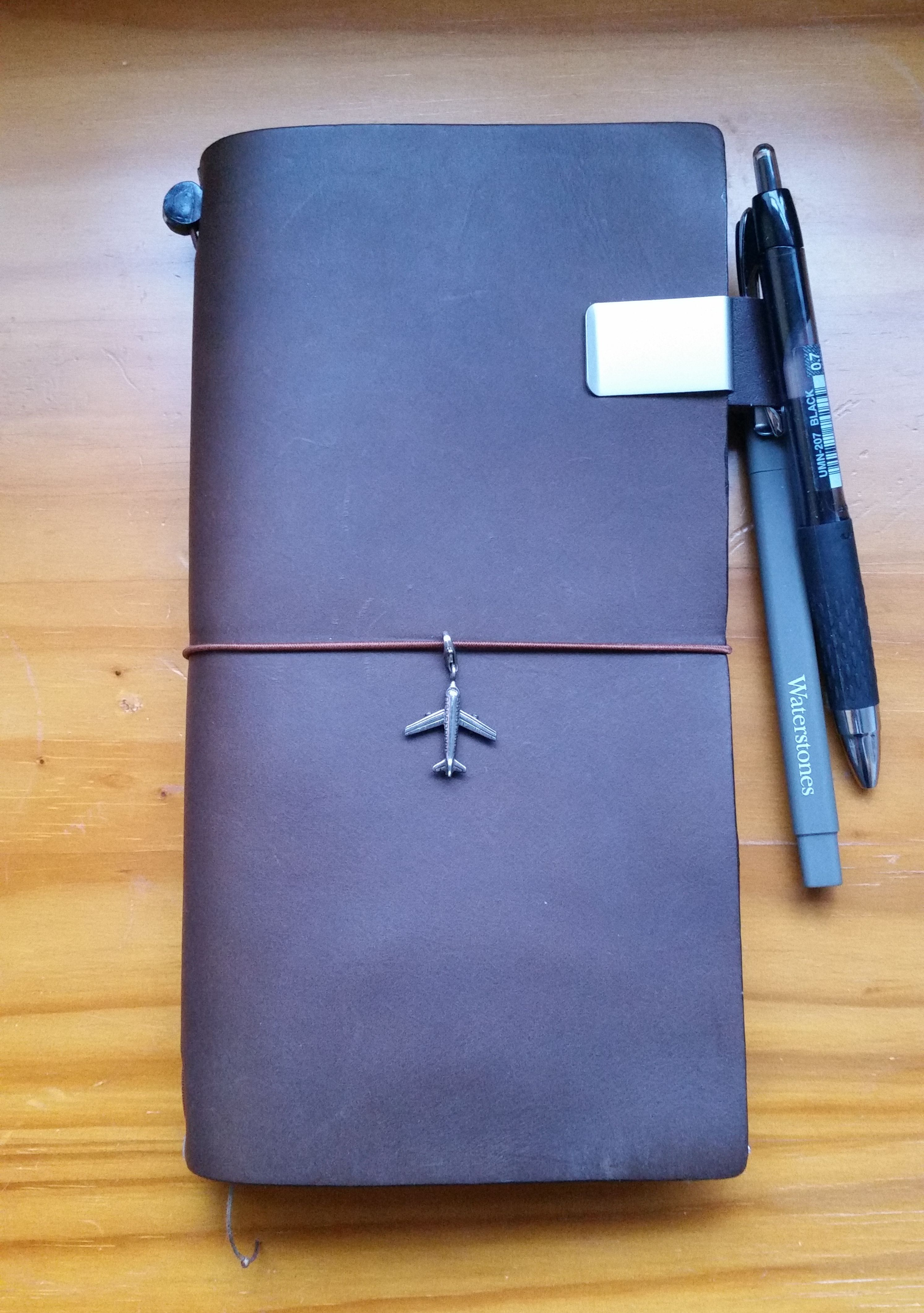Regular brown Midori all ready for its first trip abroad. So excited! Recently added the plane charm.