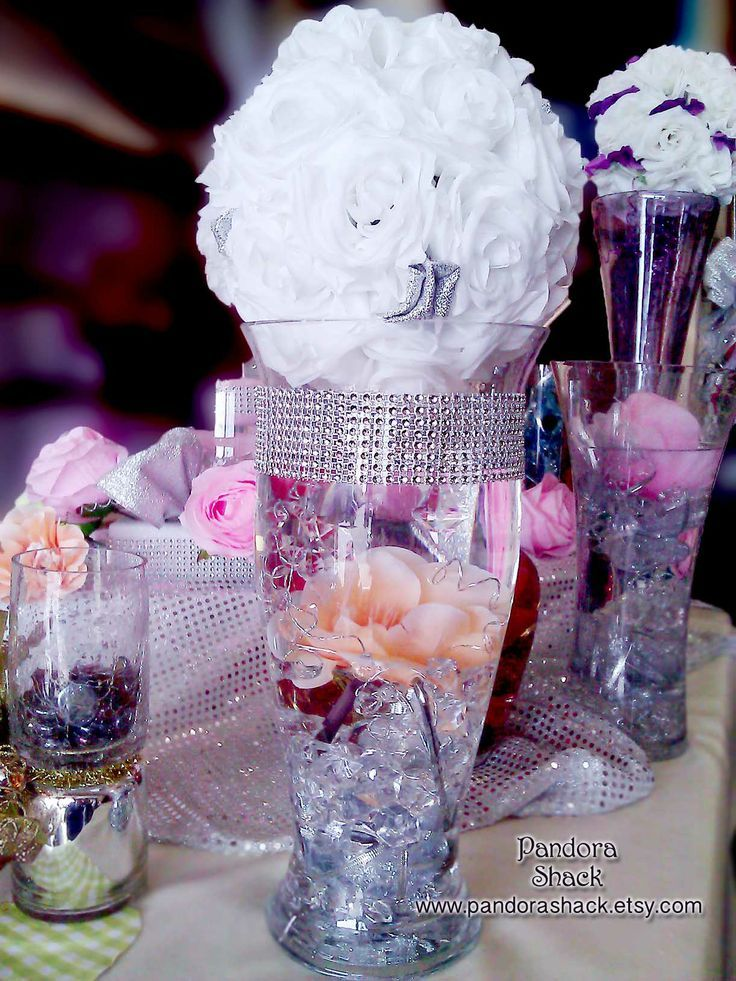 Simple way to add 'bling' to center piece vases, just wrap diamond mesh around, and there you have it! Diamond mesh can be  found here: https://www.etsy.com/listing/104604314/sale-diamond-mesh-illusion-jewel-like?ref=shop_home_active