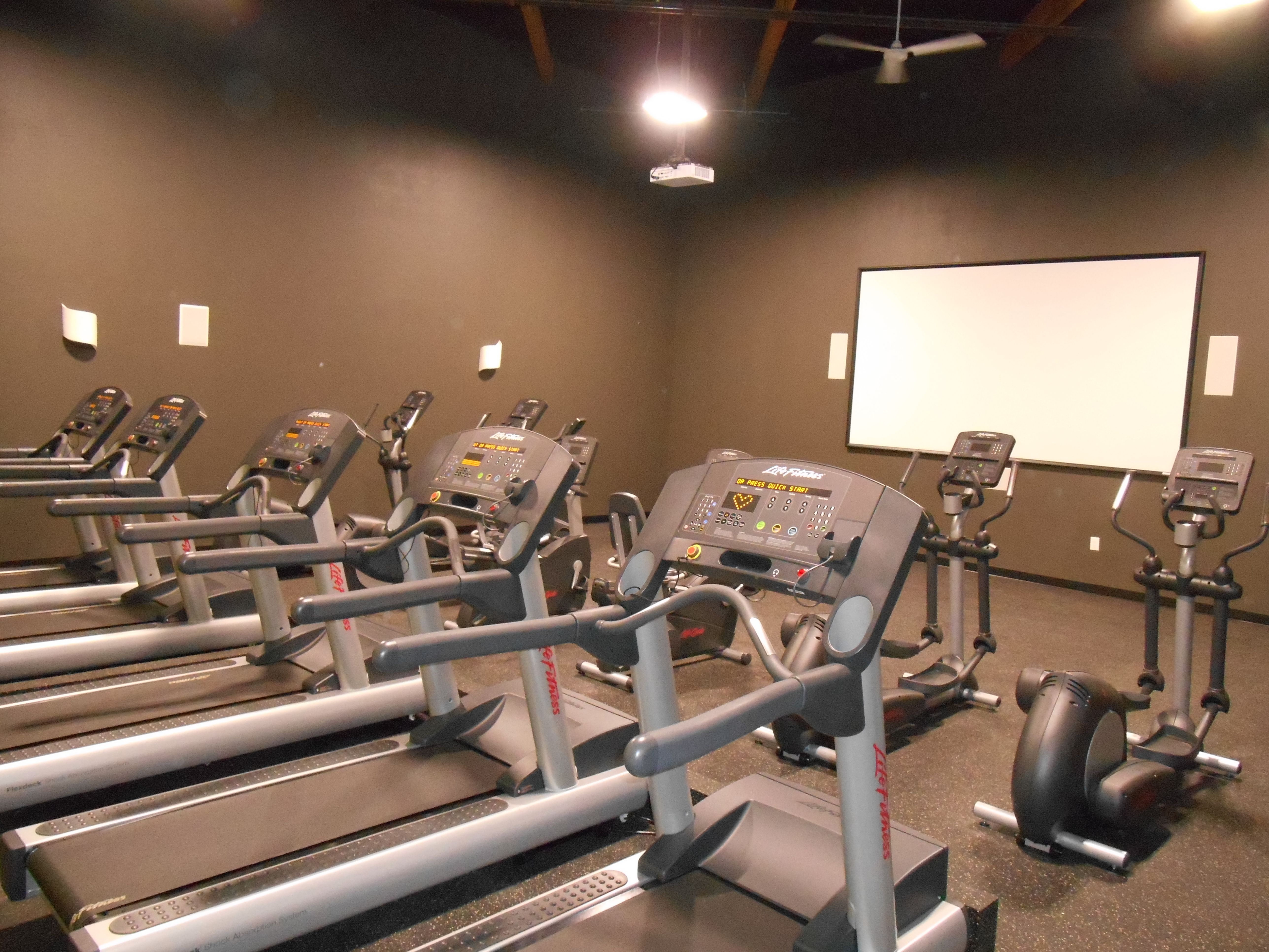 The Q-Max Cardio theater at Physiq Fitness, South Salem location. The only  theater of this type in Oregon, it boasts surround sound, HDTV, ...