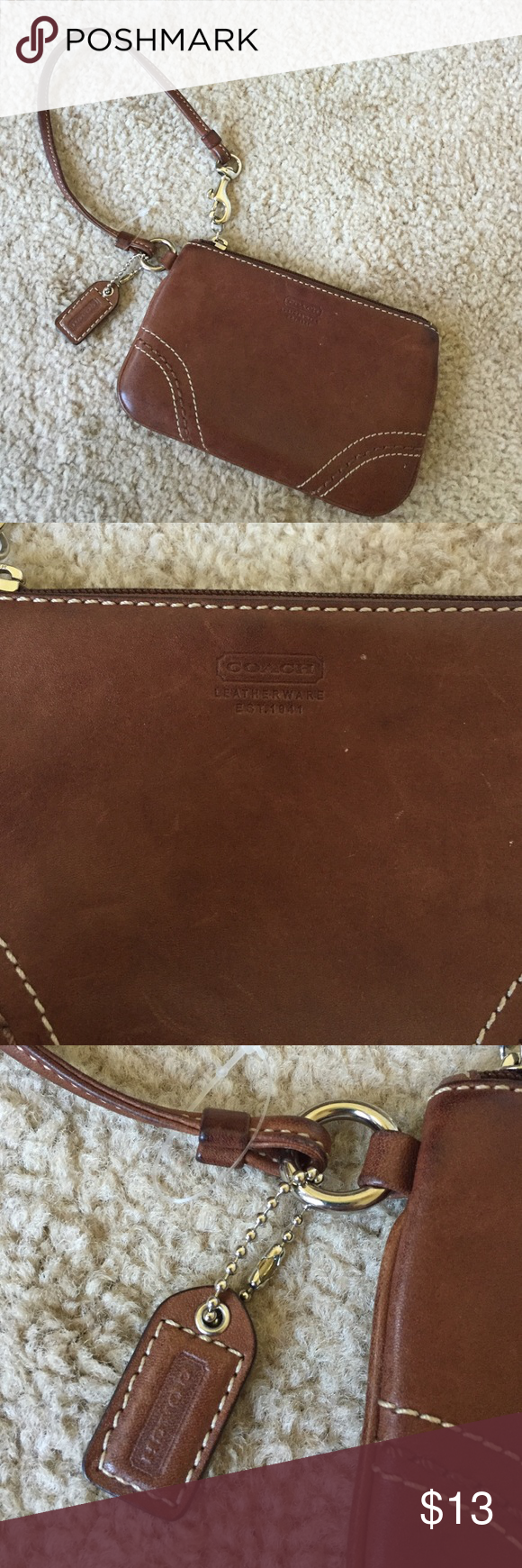Coach chocolate brown leather wristlet Some scratches here and there. Great overall condition! No interior stains Coach Bags Clutches & Wristlets