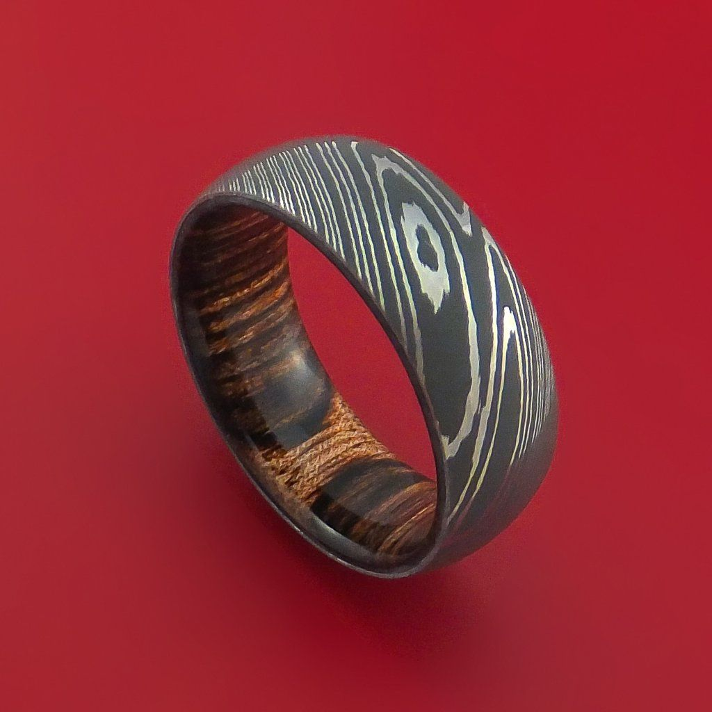 Damascus steel ring with heritage brown hardwood interior sleeve