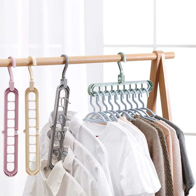 9 Hole Space Saving Hanger 360 Rotating Magic Multi Function Folding H Ozzy Bella All Great Apparel Space Saving Hangers Folding Hanger Hanger