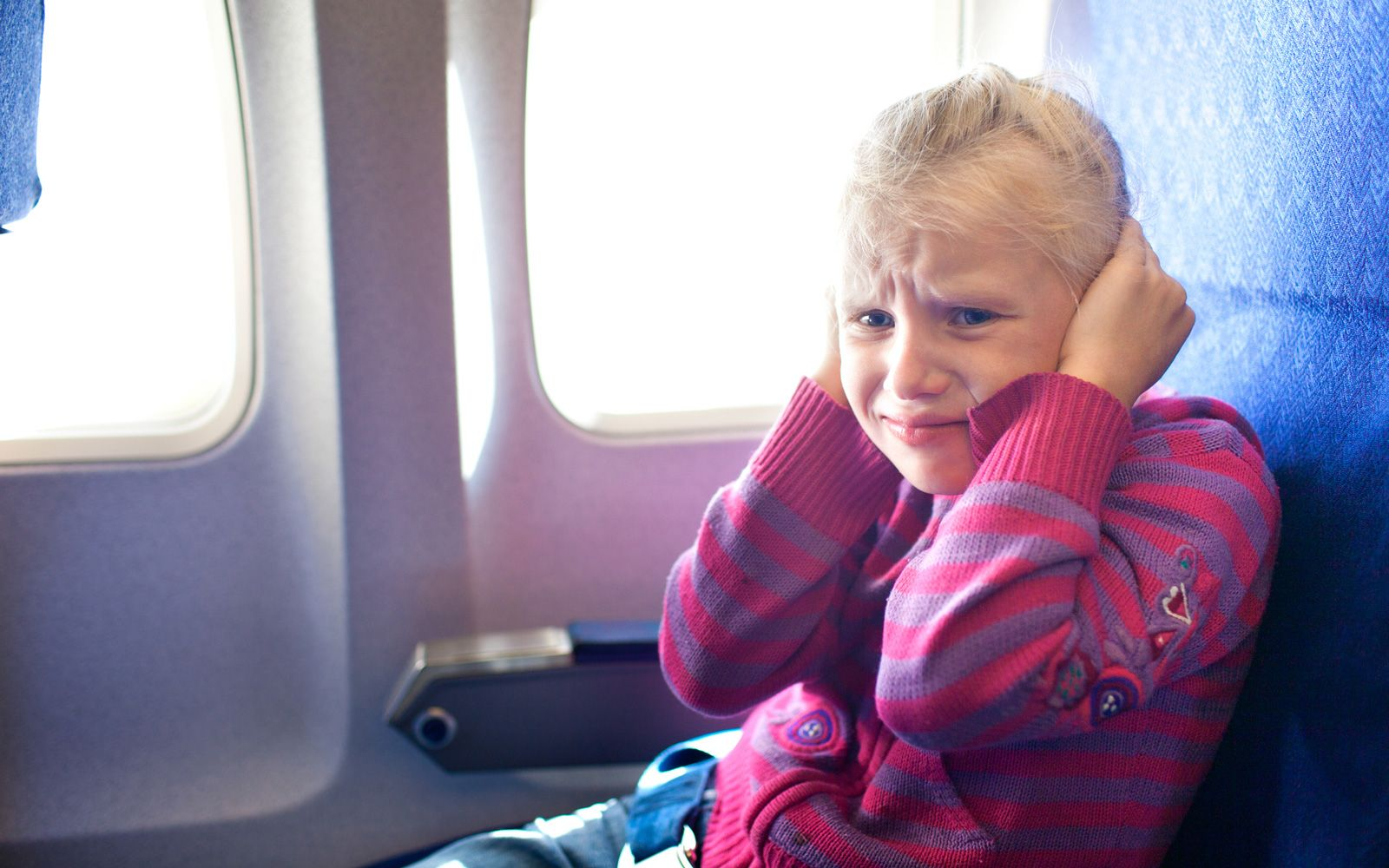 how to stop popping ears on airplane