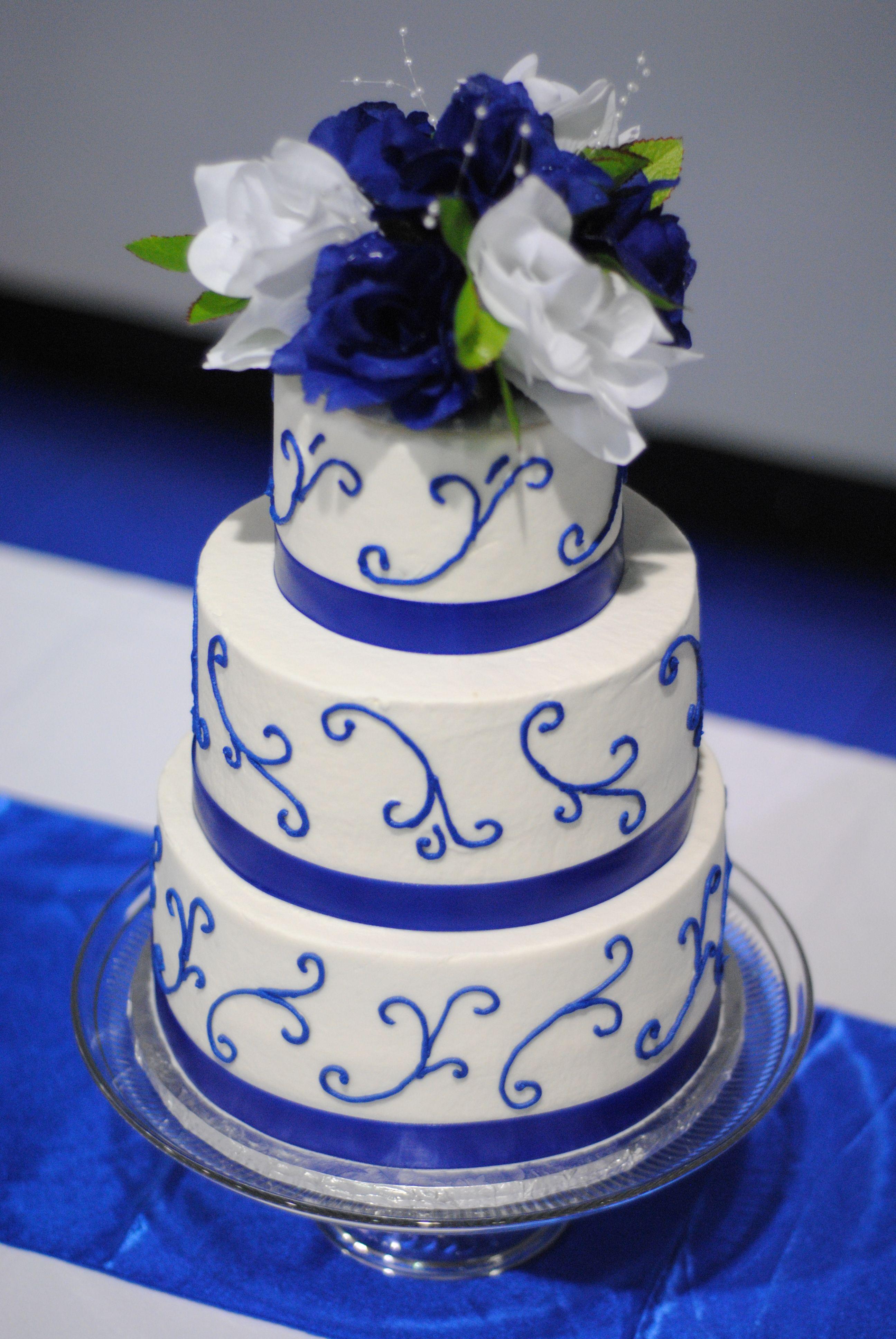 Royal blue and white swirl wedding cake