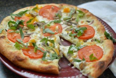 Creamy Delicious Veggie Alfredo Pizza  This Alfredo Pizza is covered in fresh veggies.