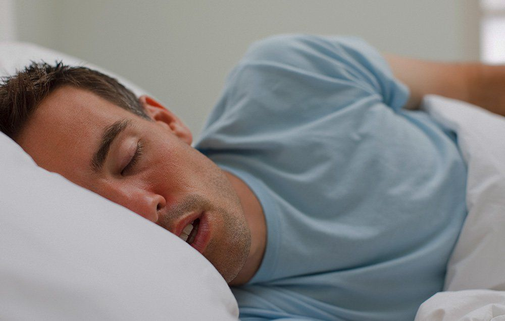 what causes acid reflux when sleeping