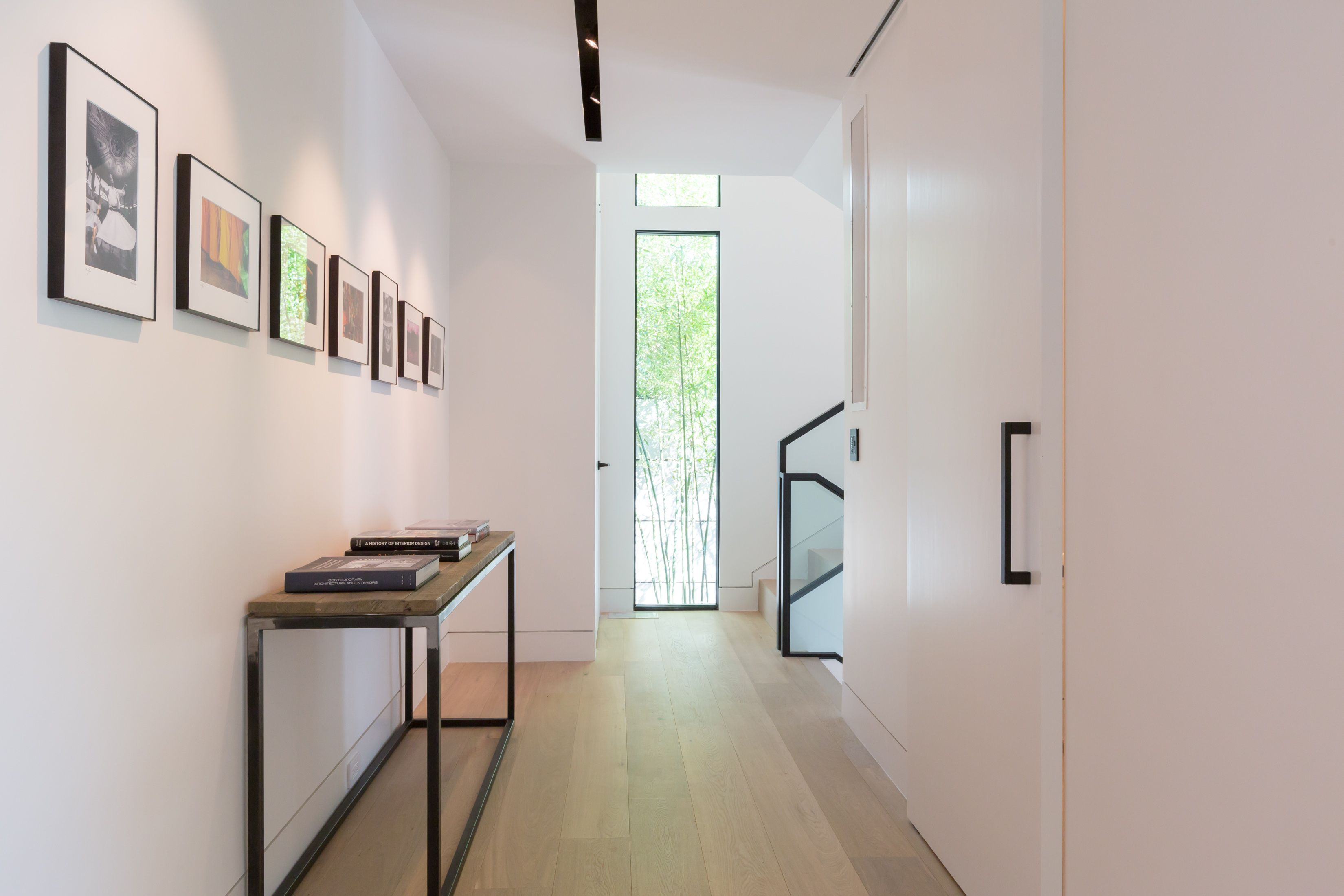 Modern hallway with recessed trim less track lighting by Viabizzuno