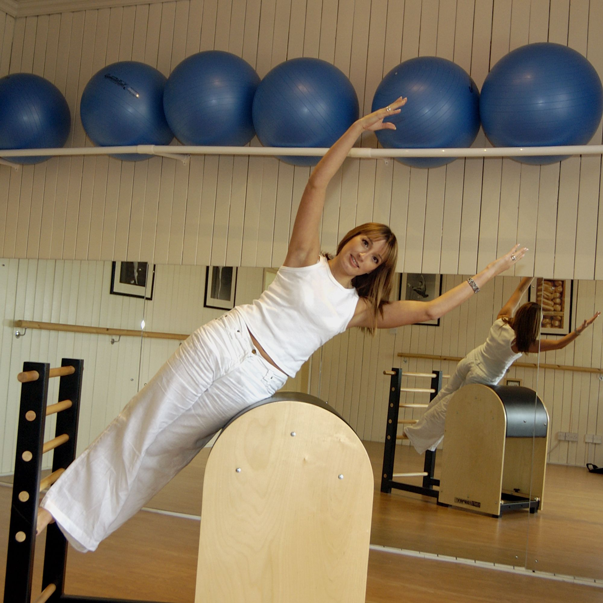 Mermaid Obliques Exercise On The Pilates Ladder Barrel