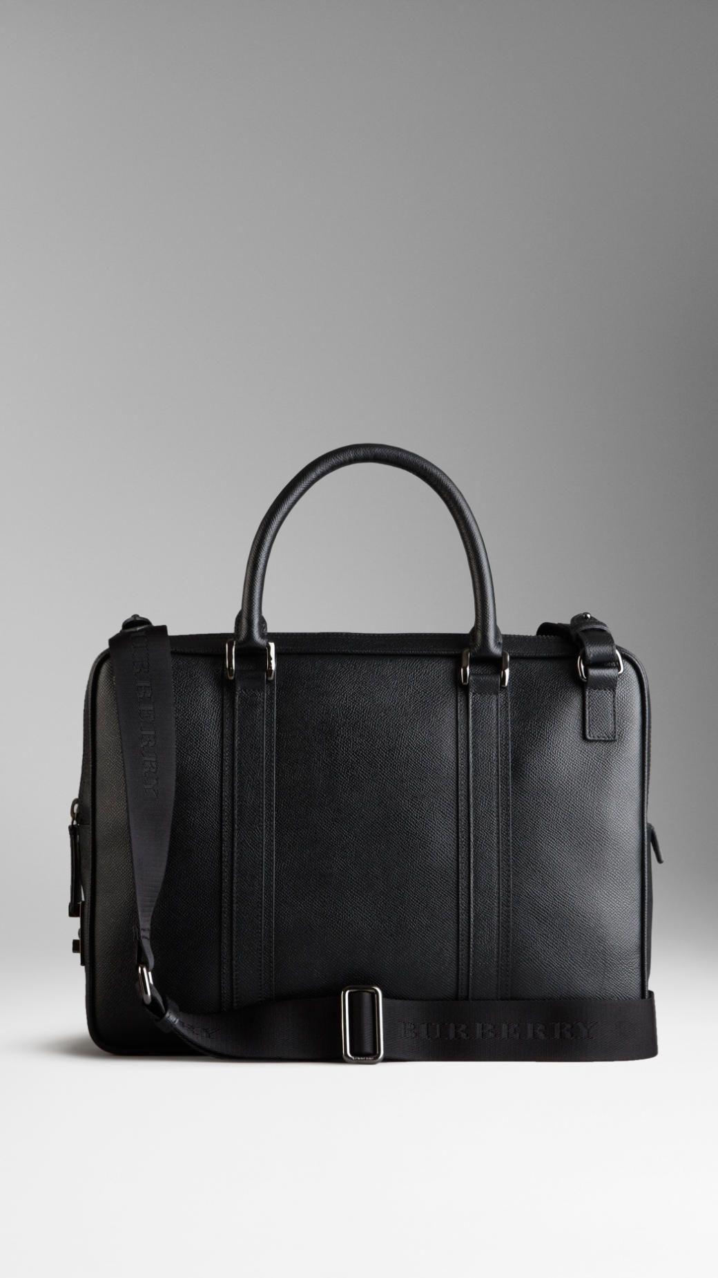 London Leather Crossbody Briefcase | Burberry $1,695.00 Item 38608881 BLACK         London leather crossbody briefcase with protective padding         Zip closure, rolled leather handles, detachable webbed canvas crossbody strap         Polished metal hardware         27 x 37 x 7cm         10.6 x 14.6 x 2.8in         100% calf leather         Imported