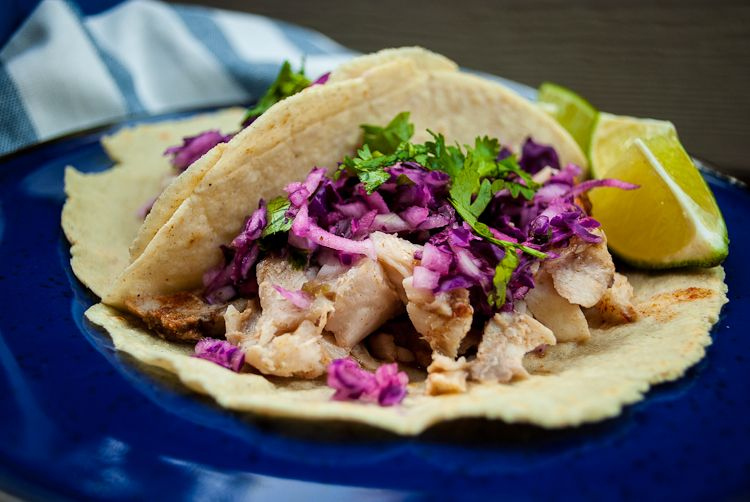 Fish Tacos  ◦For the Fish  ◦2 lbs of white fish, I use Rockfish  ◦1 tsp of spanish cumin  ◦1 tsp of smoked paprika  ◦1 tsp of crushed red pepper flakes  ◦salt and pepper  ◦For tortillas  ◦Mesa flour, found in most grocery stores in the Mexican isle  ◦olive oil  ◦water  ◦salt  ◦For the spicy slaw  ◦1 head of purple cabbage  ◦1 jalapeno pepper  ◦1 Serrano pepper  ◦3 cloves of garlic  ◦1 onion  ◦juice from 2 limes  ◦salt, pepper  ◦chopped cilantro for garnish