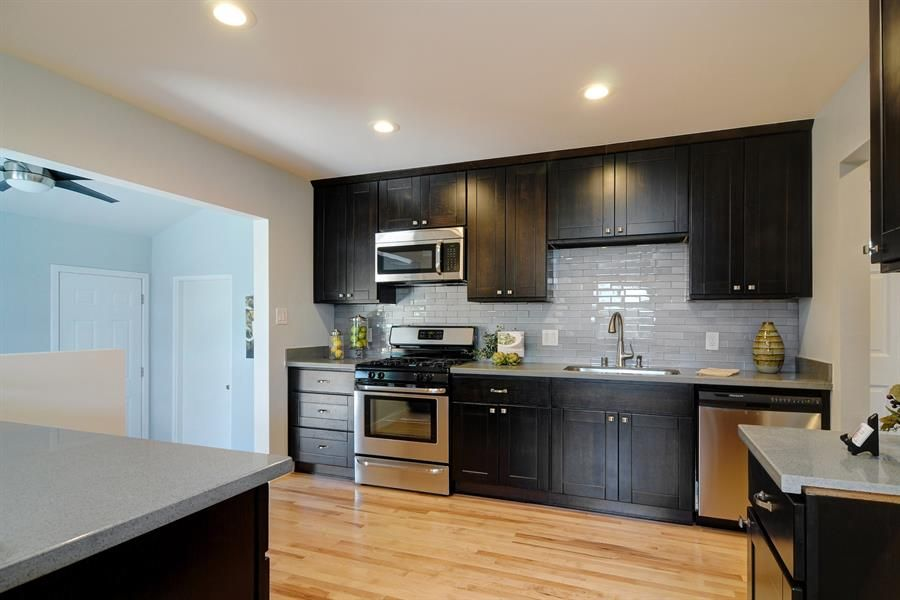Espresso kitchen cabinets with wood floors 01 kitchen for Cappuccino color kitchen cabinets